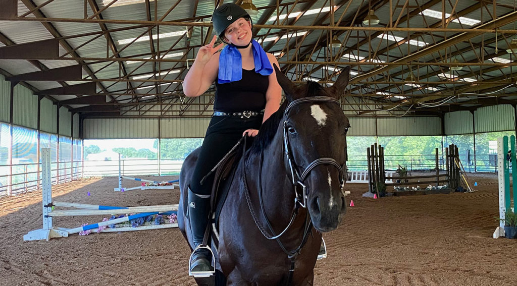 Claire riding Mozart